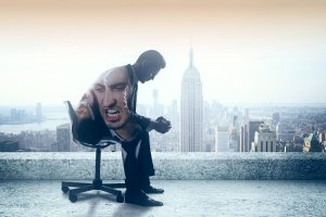 Sad businessman with anger issues sitting on rooftop with New York city view. Double exposure